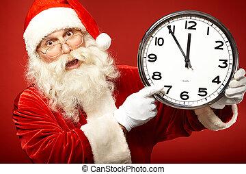 Forthcoming Christmas - Photo of Santa holding clock showing...