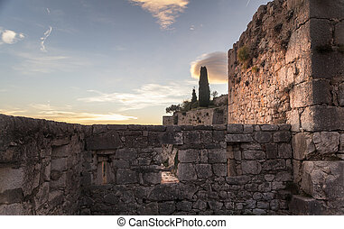 Fortification - Old walls of a fortification in sunset in...