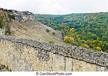 Fortified walls of town chufut kale in Crimea - Fortified...