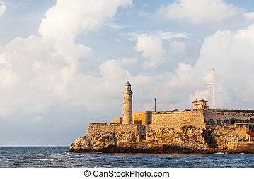 Fortress and lighthouse of El Morro in the entrance of Havana bay, Cuba. Sunset after storm.