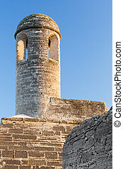 Fortress Bell Tower - A tall bell tower stands on on corner...
