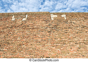 Fortress brick wall and sky as background