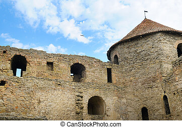 Fortress tower with tiled roof on blue sky background. Location place Ukraine, Europe.