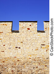 Fortress wall against the blue sky