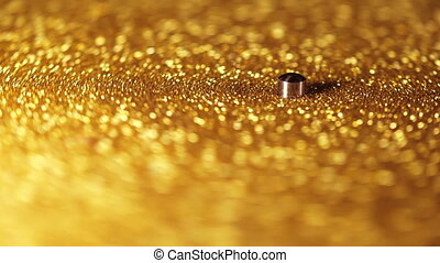 Fortuna gold, record player turntable vinyl with golden glitter. Analog audio equipment, nightclub disco, retro style concept. High quality 4k footage