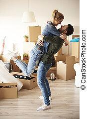 fortunato, coppia abbracciando, in, casa nuova