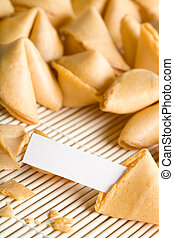 fortune cookies - one cookie open with blank fortune for your text. Entire text area in focus.