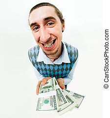 Fortune - Shot of positive man with dollars in hands looking...