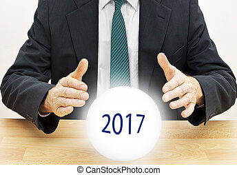 Fortune teller businessman predicting future new year 2017 with crystal ball
