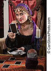 Fortune Teller Dealing Tarot Cards - Pretty female gypsy ...