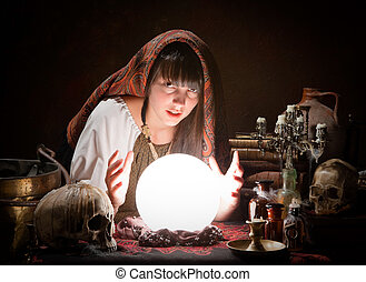 Fortune-teller predicting the future - Young fortune-teller...