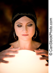 Fortune teller - Pretty gypsy woman with her hands on a...