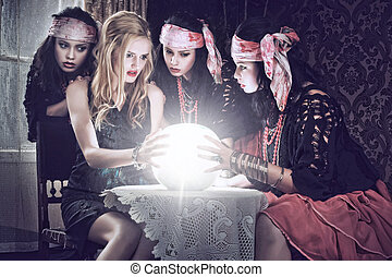 fortune teller with her crystal ball. Illusion