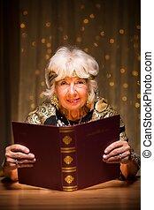 Fortune teller with magic spellbook - Smiling elderly ...