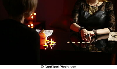 fortuneteller. divination by the runes. woman engaged in magic