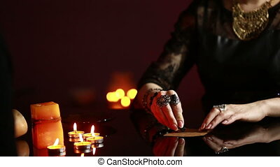 fortuneteller. divination by the runes. woman engaged in...