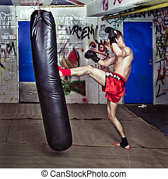 Forward kick - Muay Thai fighter giving a forceful forward ...