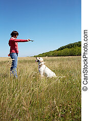 Forward - Photo of woman training her dog