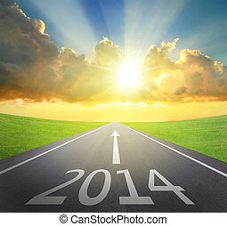 Forward to 2014 new year concept , asphalt road with arrow , date and beautiful sunset and sunshine