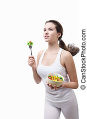 Forward to a healthy diet - Beautiful girl running with a ...