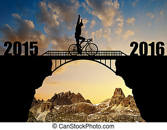 Forward to the New Year 2016 - Cyclist riding across the...
