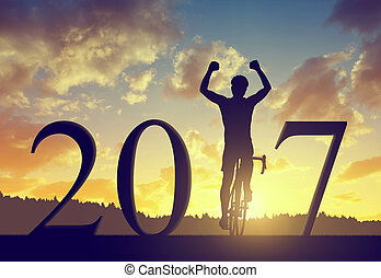 Forward to the New Year 2017 - Cyclist on bicycle at sunset....