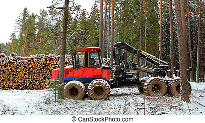 Forwarder at Winter Logging Site - Forwarder and stack of...