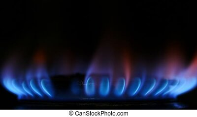 Heat energy from Natural Gas fossil fuel flame in kitchen stove gas burner 4K