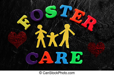 Foster Care family - Paper family with Foster Care letters...
