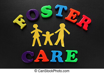 Foster Care - Paper cutout people with Foster Care letters...