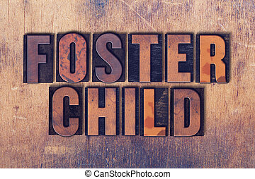 Foster Child Theme Letterpress Word on Wood Background