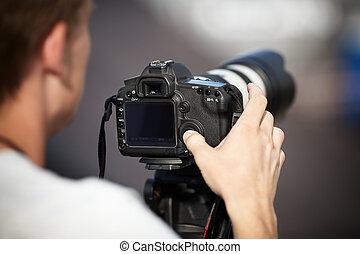 fotógrafo, com, lente telephoto