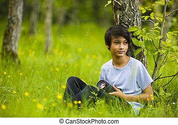 fotógrafo, menino jovem, em, natureza