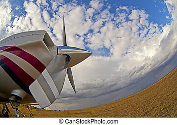 foto of an small airplane on green grass and sunset ...