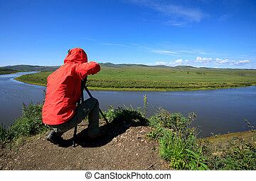 fotograf, aufnahme nehmend, in, schöne , landschaftsbild