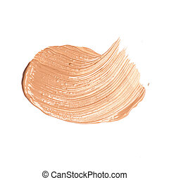 Foundation color sample smeared on white background