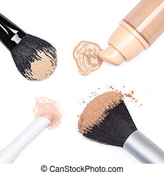 Foundation, concealer pencil and powder with makeup brushes...