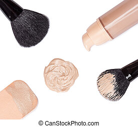 Foundation with makeup brushes and cosmetic sponge - Closeup...