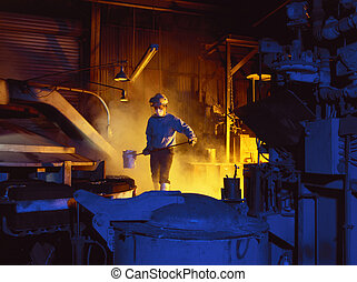 a foundry worker about to pour molten metal