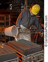 Foundry Worker  - Foundry worker pouring molten aluminum