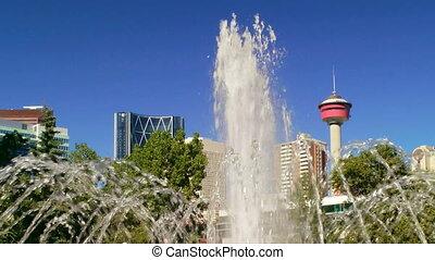 Calgary Tower through the fountain at Central Memorial Park, Canada