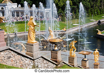 Canal with fountain and golden statues in lower park of Peterhof. Russia, St.Petersburg.