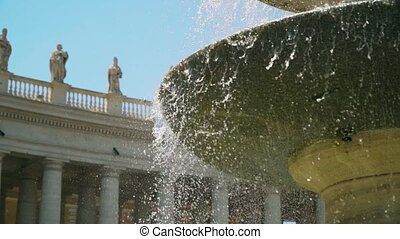 Fountain at the dome of the Basilica of St. Peter. Vatican City. Slow mo camera