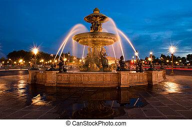 Fountain at the Place de la Concorde in Paris by night,...