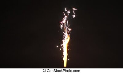 fountain firework burning over black background -...