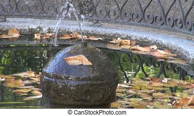 Fountain in autumn park in Madrid