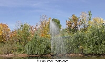 Fountain in autumn Park