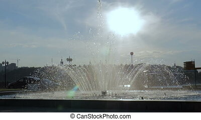 Fountain in the center of the city. A bright sunny day. Slow motion