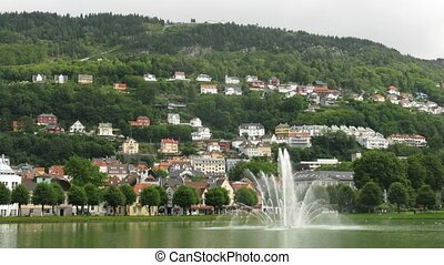 Fountain in the park under mountain in Bergen, time lapse
