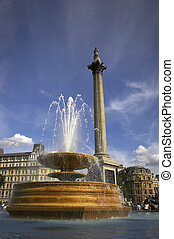 Trafalgar square - Fountain in Trafalgar square with nelsons...